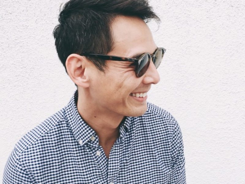 young-man-smiling-with-sunglasses_t20_z9YG6J